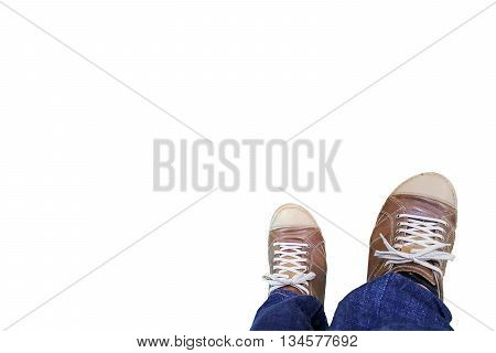 Two legs of the men wore blue jeans statements and brown leather shoes isolated on white background.