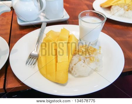 Mango sticky rice dessert is famous in Thailand.