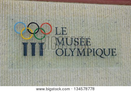 Lausanne Switzerland June 3, 2014 sign and symbol of Olympic museum at main entrance office headquarter