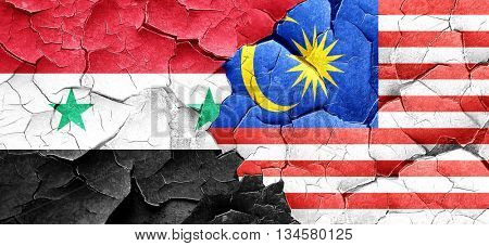 Syria flag with Malaysia flag on a grunge cracked wall