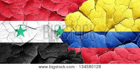 Syria flag with Colombia flag on a grunge cracked wall