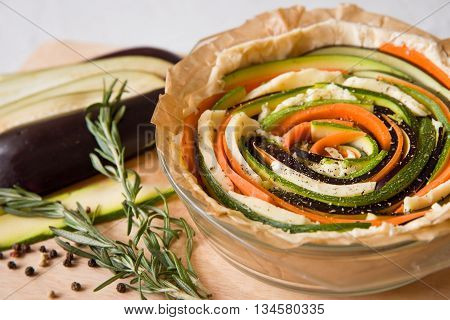 Vegetarian pie with eggplants carrots squash zucchini pepper and rosemary. Baking for healthy dinner. Lunch idea