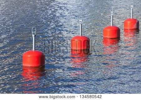 Red Mooring Buoys In A Row, European Marina
