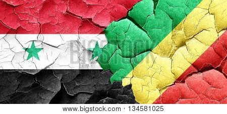 Syria flag with congo flag on a grunge cracked wall