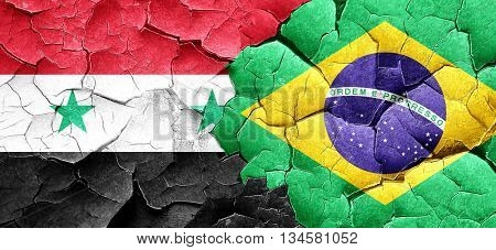 Syria flag with Brazil flag on a grunge cracked wall
