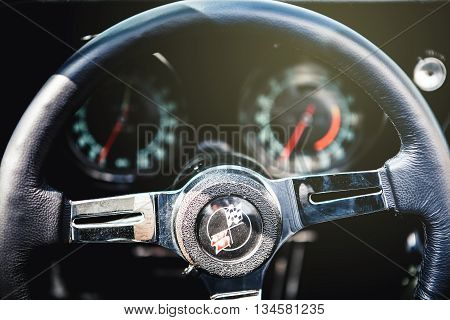 Benalmadena, Spain - June 21, 2015: Steering wheel detail of Chevrolet Corvette C3, in Benalmadena (Spain), on June 21, 2015.