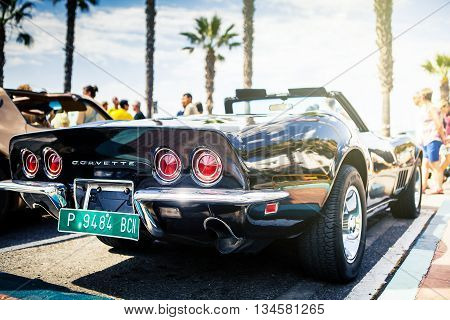 Benalmadena, Spain - June 21, 2015: A black Chevrolet Corvette C3 back viewed, parked in the port of Benalmadena (Spain), on June 21, 2015.