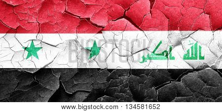 Syria flag with Iraq flag on a grunge cracked wall