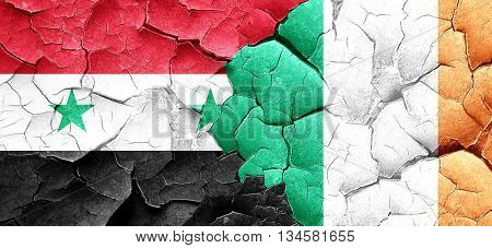 Syria flag with Ireland flag on a grunge cracked wall