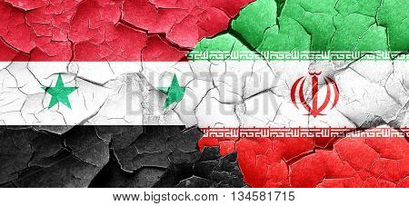 Syria flag with Iran flag on a grunge cracked wall