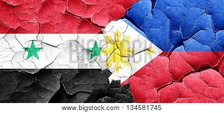Syria flag with Philippines flag on a grunge cracked wall