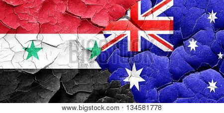 Syria flag with Australia flag on a grunge cracked wall