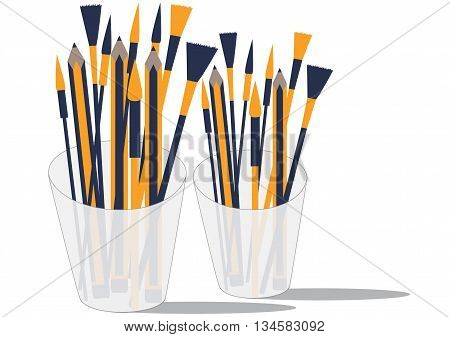 The pencil and paintbrush in a glass.