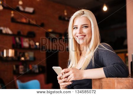 Close-up portrait of a smiling female receptionist of beauty salon