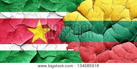 Suriname flag with Lithuania flag on a grunge cracked wall