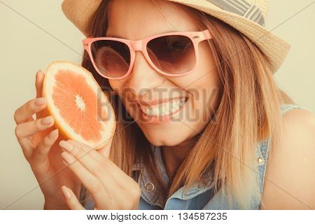 Happy glad woman tourist in straw hat drinking grapefruit juice. Healthy diet food. Weight loss. Summer vacation holidays. Instagram filtered.
