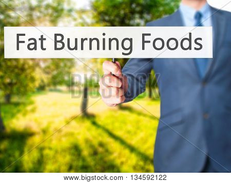 Fat Burning Foods - Businessman Hand Holding Sign