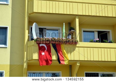 residential house decorated with german and turkish flag