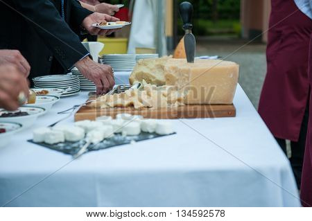 Particular Of Grana Cheese During A Wedding Party