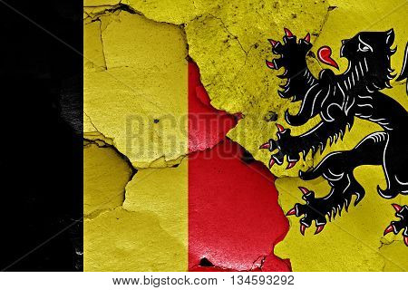 Flags Of Belgium And Flanders Painted On Cracked Wall