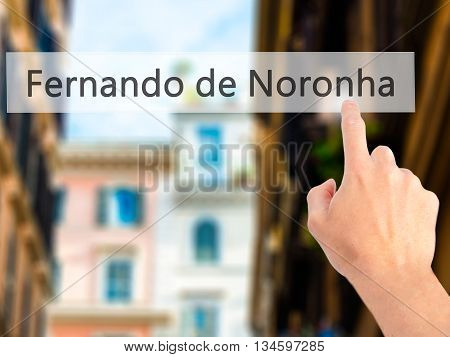 Fernando De Noronha - Hand Pressing A Button On Blurred Background Concept On Visual Screen.