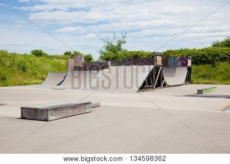 Skatepark with a Halfpipe and Ramps with blue sky