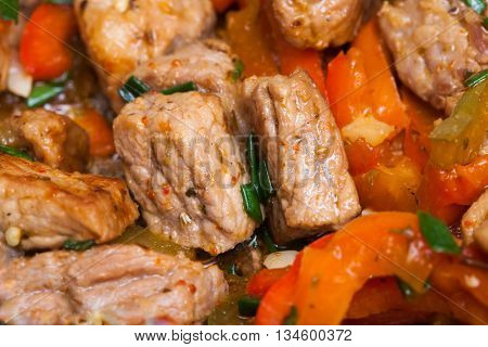 Homemade Fried Pork With Sweet Peppers Closeup