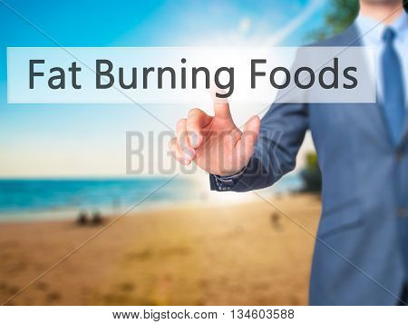 Fat Burning Foods - Businessman Hand Pressing Button On Touch Screen Interface.