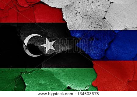 Flags Of Libya And Russia Painted On Cracked Wall