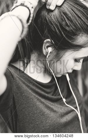 Woman Listening Music Media Tied Up Ponytail Concept