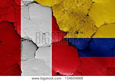 Flags Of Peru And Colombia Painted On Brick Wall