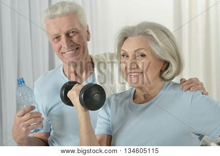 Portrait of a happy sporty senior couple exercising