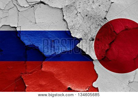 Flags Of Russia And Japan Painted On Cracked Wall