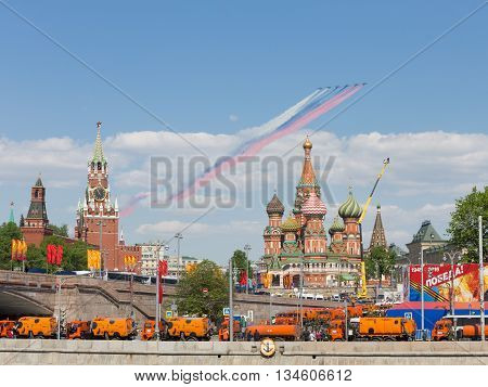 Moscow - May 9 2016: At the end of the parade the Victory six Su-25 flew with smoke painted in the colors of the Russian flag over St. Basil's Cathedral and 9 May 2016 Moscow Russia