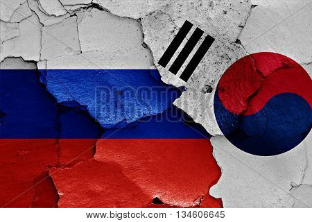 Flags Of Russia And South Korea Painted On Cracked Wall