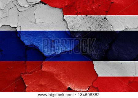 Flags Of Russia And Thailand Painted On Cracked Wall