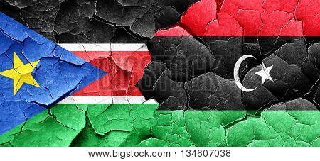 south sudan flag with Libya flag on a grunge cracked wall