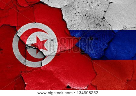 Flags Of Tunisia And Russia Painted On Cracked Wall