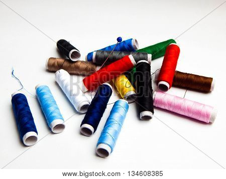 Bobbins of thread on a white background.