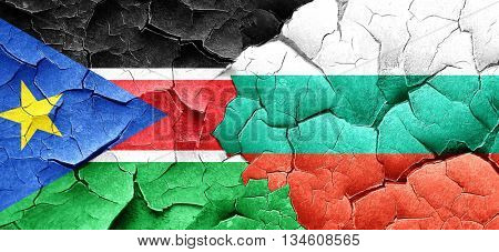south sudan flag with Bulgaria flag on a grunge cracked wall