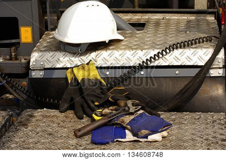 Hard hat adjustable wrench protective gloves construction.