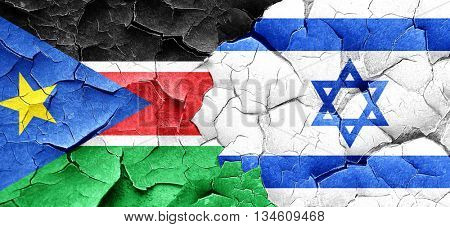 south sudan flag with Israel flag on a grunge cracked wall