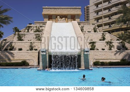 LAS VEGAS ,NEVADA, MAY 23. The Cancun Resort on May 23, 2016, in Las Vegas, Nevada. A group of bathers enjoys the dramatic Mayan waterscape and pyramid at the Cancun Resort in Las Vegas Nevada.
