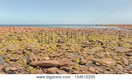 Rocky coastline of Stokes Bay jutting out into the Investigator Strait, Kangaroo Island, South Australia.