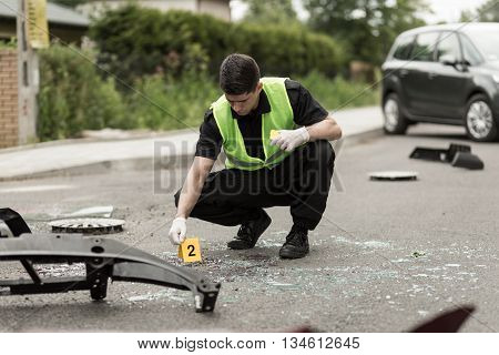 Police Officer Securing Accident Scene