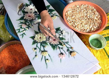 YEN BAI, VIETNAM, December 14, 2015 hands, artisan design gemstone paintings, village, gemstone paintings producer Luc Yen, Yen Bai Province, Vietnam
