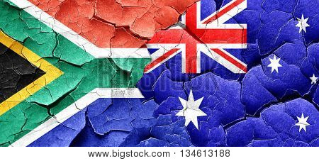 South africa flag with Australia flag on a grunge cracked wall