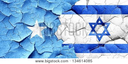 Somalia flag with Israel flag on a grunge cracked wall