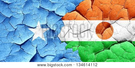 Somalia flag with Niger flag on a grunge cracked wall