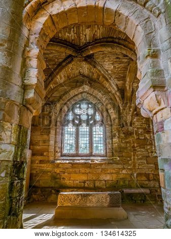Chapel at the ruins of Jedburgh Abbey in the Scottisch Borders region in Scotland hdr look